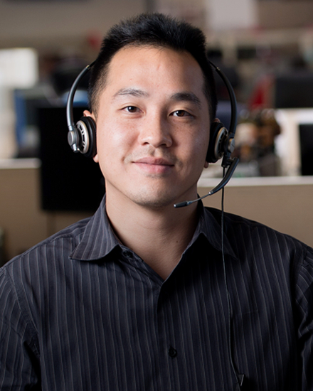 A Con Edison customer service representative wearing a headset.