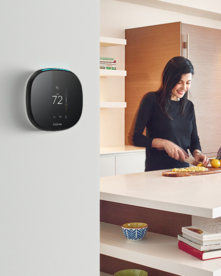 A Smart Thermostat mounted on a kitchen wall
