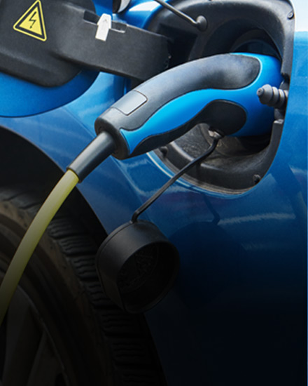 A photo of an electric vehicle being charged