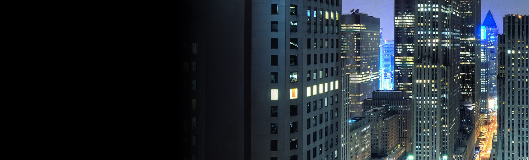 Skyscrapers at dusk with lit windows