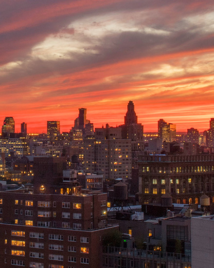 View of NYC neighborhood at sunset