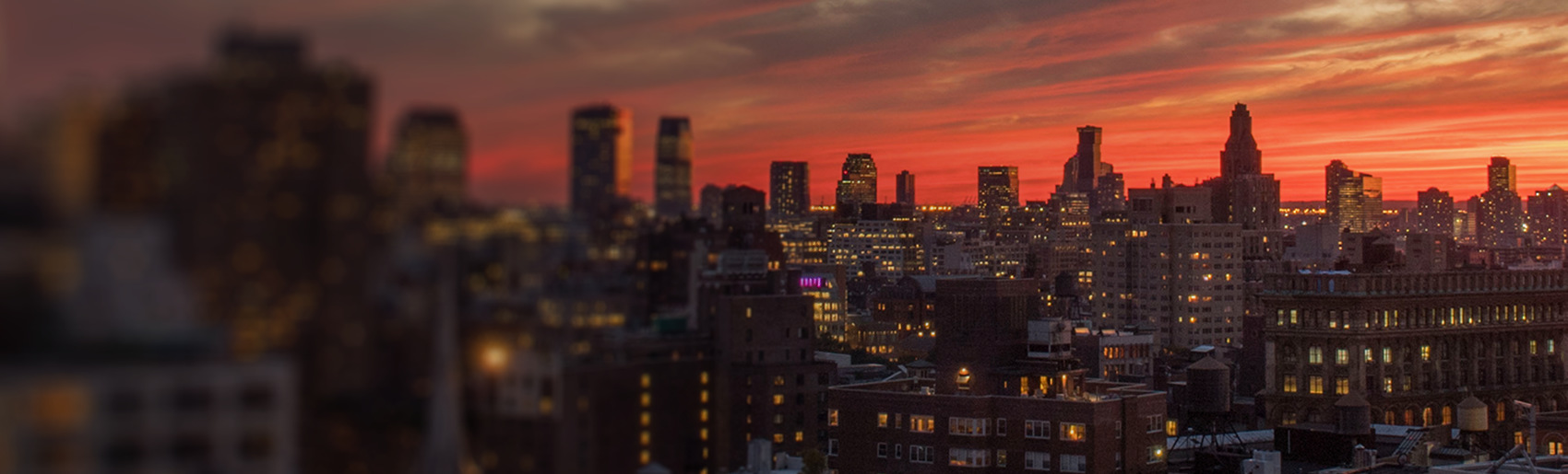 A deep red sunset over the Brooklyn cityscape.