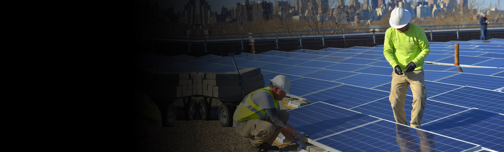 Solar panels are being installed on a rooftop in New York City