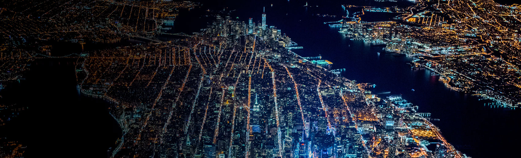 A nighttime aerial view of New York City.