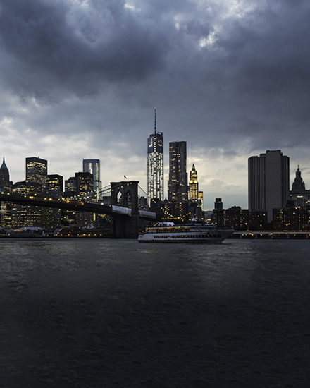 A view of New York City with storm clouds in the background