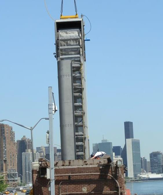 Workers installing the screens that protect marine life in the East River