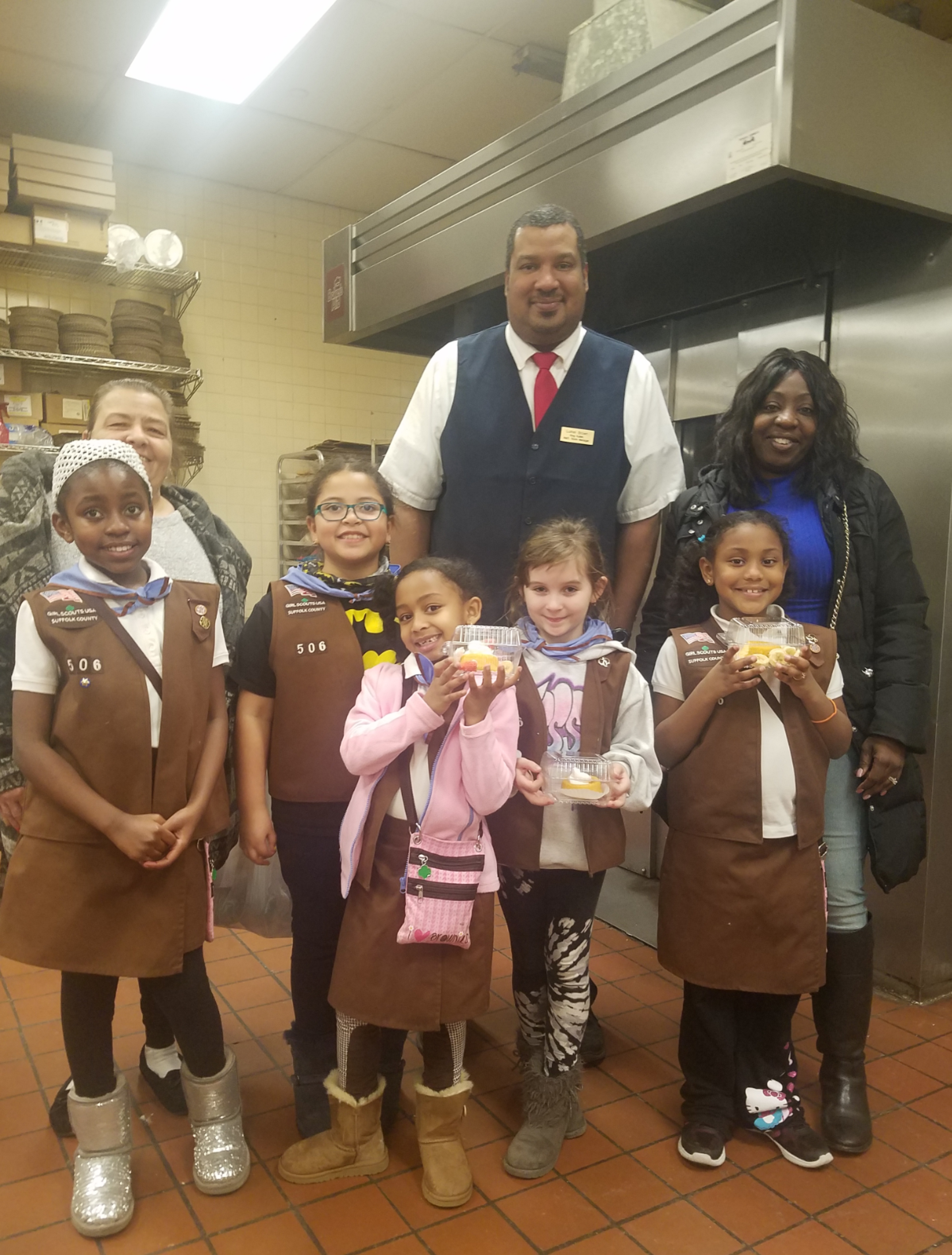 Sheryl Coleman pictured with a group of Girl Scouts