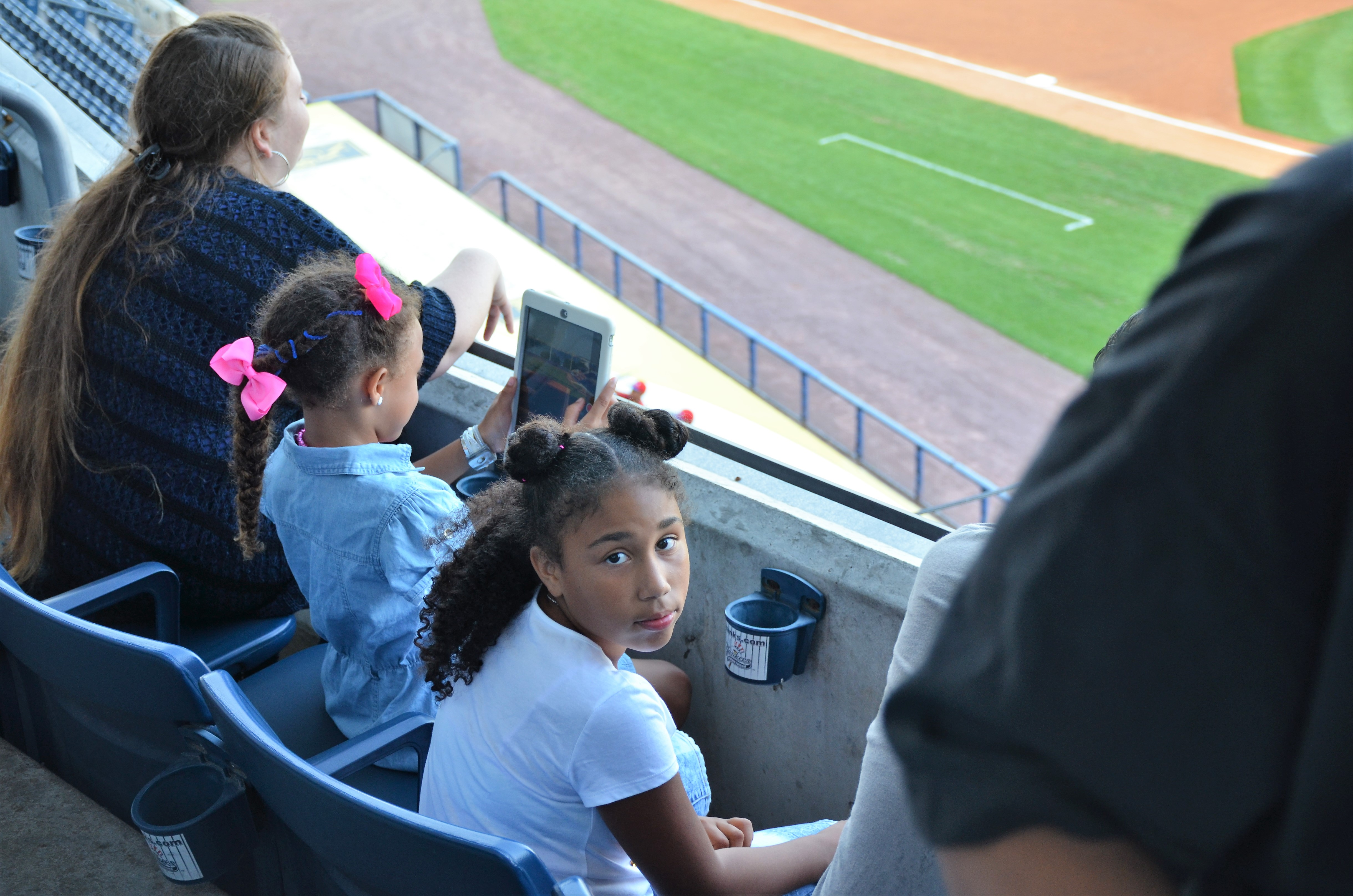 Staten Island Yankees/Con Edison Kid Triniti Jackson enjoying watching the game from the luxury suite balcony with her family.