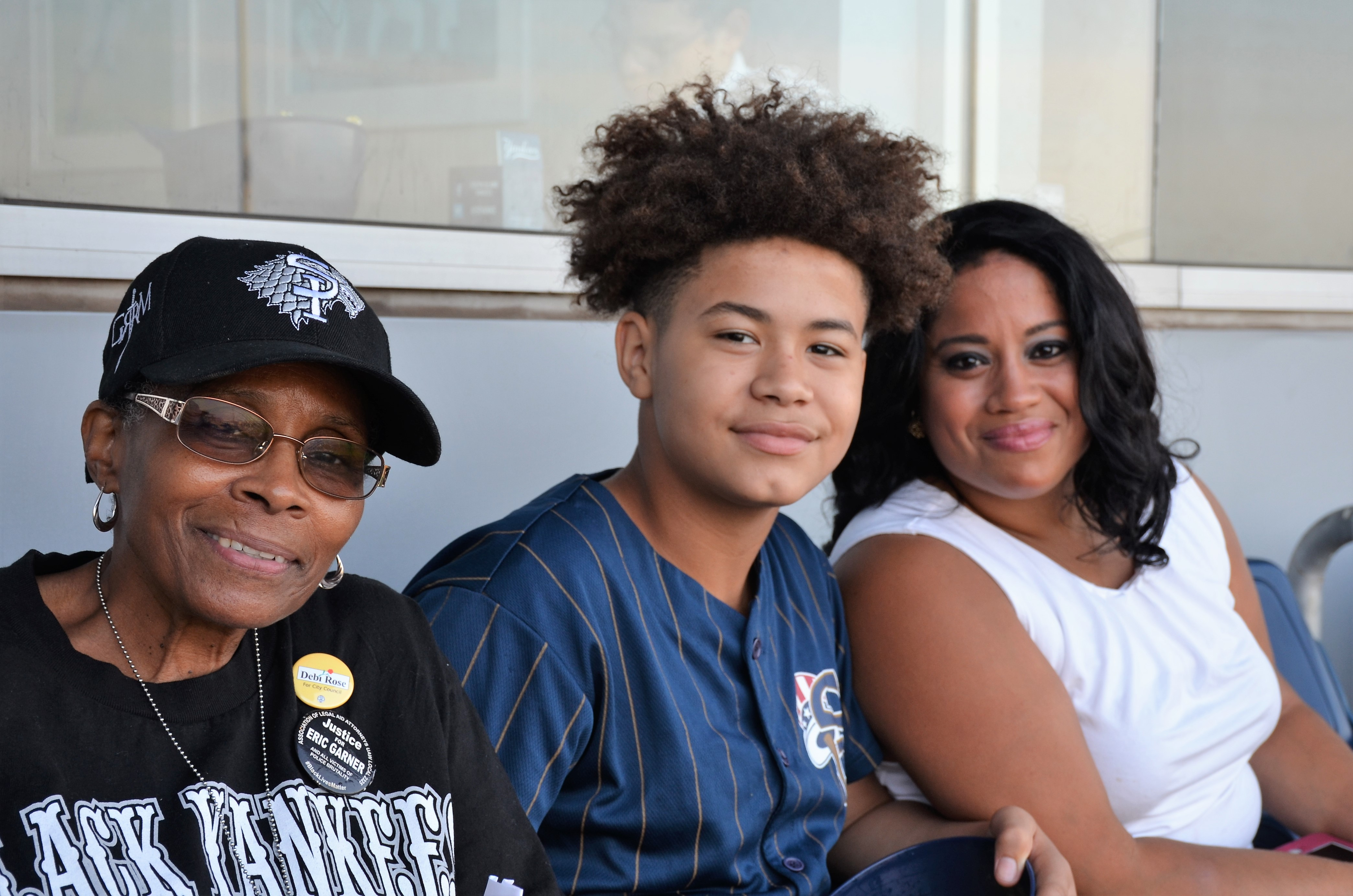 Staten Island Yankees/Con Edison Kid Sean Gomez was proud to be alongside Helen Settles, Unified Sports Activities director and his mom Chasity Jarrels.