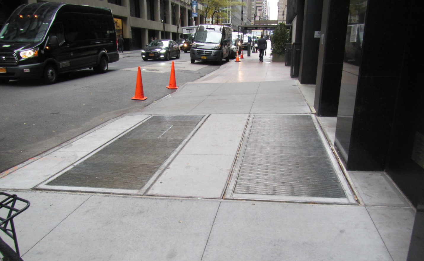 Ventilation covers on a sidewalk.