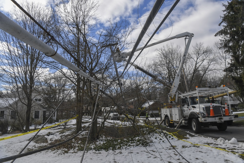 Con Edison bucket trucks restoring power