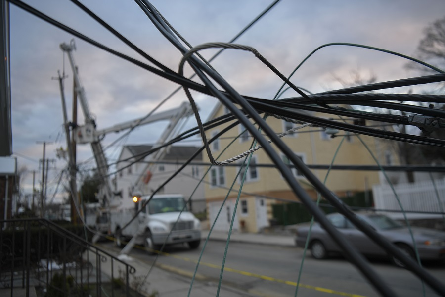 Overhead power lines, damaged during the Riley-Quinn storm series, are tangled together.