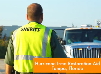 Sheriff of Tampa Florida directing traffic of restoration aid vehicles