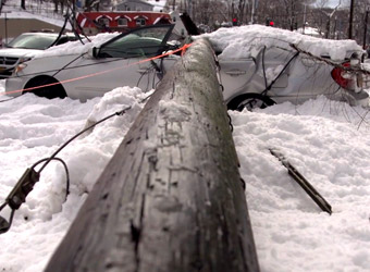 Car demolished by fallen electricity pole
