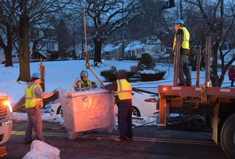 Con Edison employees working during the evening to repair damage from the Riley-Quinn storm events.