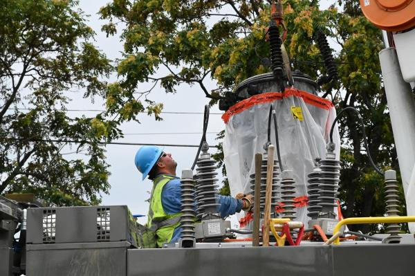 worker removing a transformer