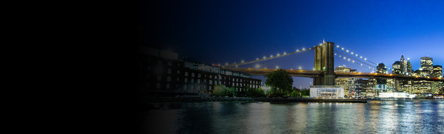 A night view of Brooklyn Bridge, and the East River